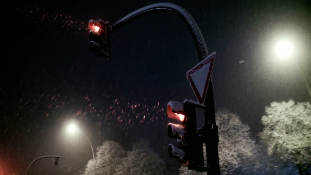 traffic signal with snow in slow motion - stoplight stock videos & royalty-free footage