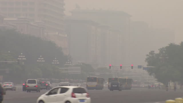 traffic, smog and street scenes in beijing, china - smog stock-videos und b-roll-filmmaterial