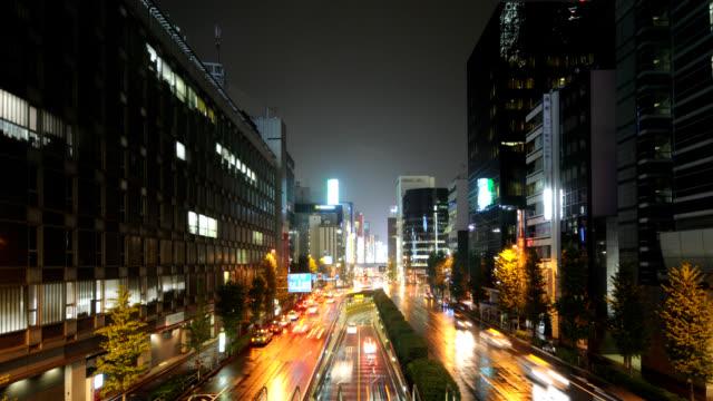 traffic speeds along a wet street in tokyo. - wet wet wet stock videos & royalty-free footage