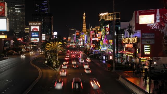traffic speeds along las vegas boulevard at night. - the strip las vegas stock videos & royalty-free footage