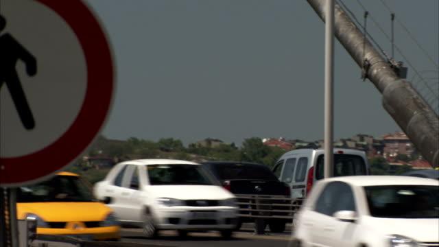 Traffic speeds past a pedestrian crossing sign in Turkey.