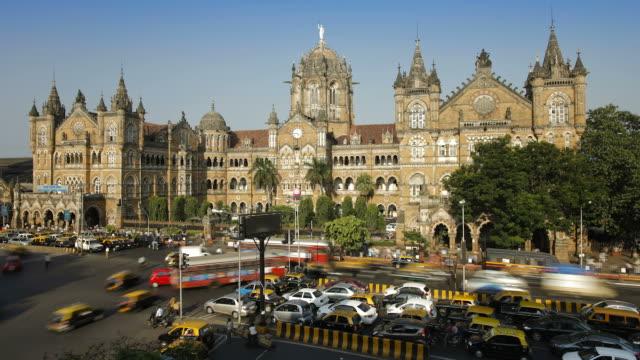 Traffic speeds past the Chhatrapati Shivaji Terminus in Mumbai.
