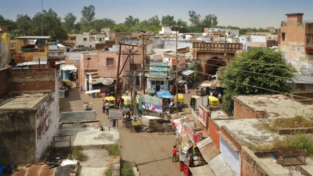traffic speeds through the town of agra, india. - agra stock videos and b-roll footage