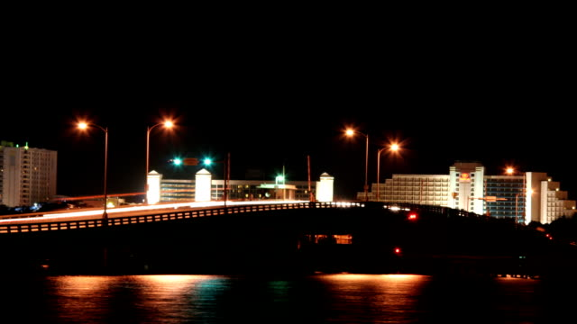 traffic streaks over the main street bridge in daytona beach, florida. - jacksonville florida stock videos and b-roll footage