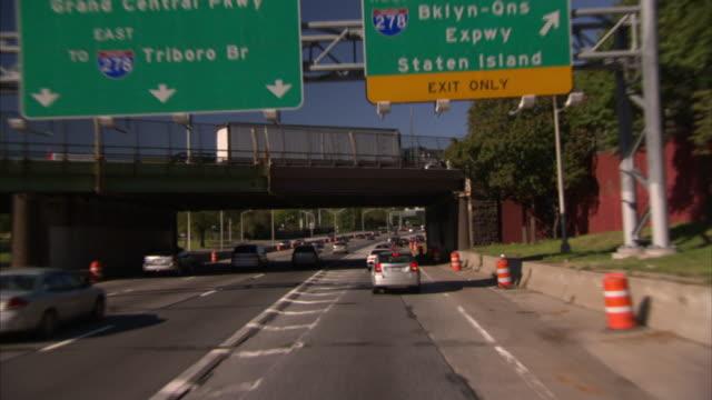 Traffic streams along a freeway in New York.