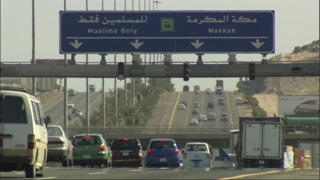 traffic streams along a freeway in saudi arabia. - saudi arabia stock videos and b-roll footage