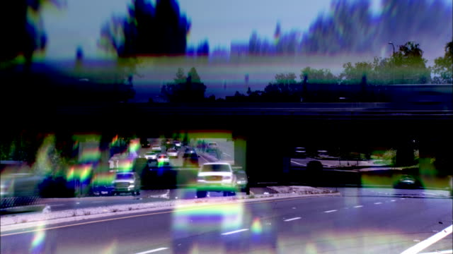 Traffic streams along freeways in Los Angeles. Available in HD.