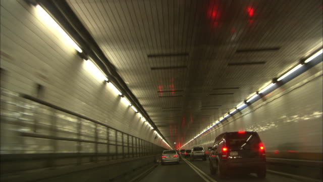 Traffic streams through a tunnel in New York City.
