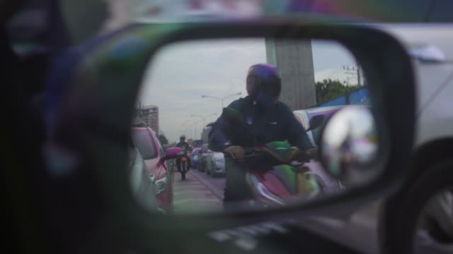 traffic that looks through the car side mirror - wing mirror stock videos & royalty-free footage