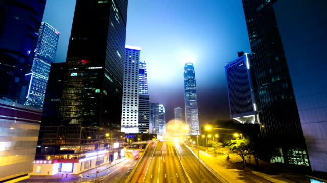 traffic through modern city at night,time lapse - office block exterior stock videos & royalty-free footage