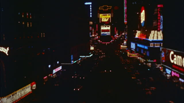 1957 WS HA Traffic through Times Square with illuminated electronic billboards / New York City, New York State, USA