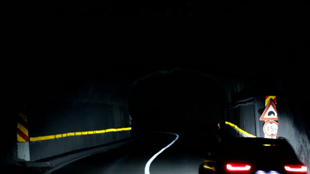 traffic through tunnel at night - vanishing point stock videos and b-roll footage