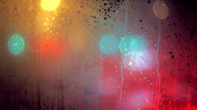 Traffic through wet glass