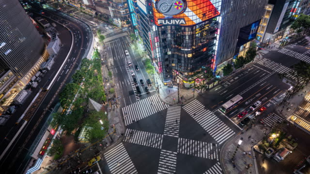 traffic time lapse, aerial view of a crossing in ginza, tokyo. - population explosion video stock e b–roll