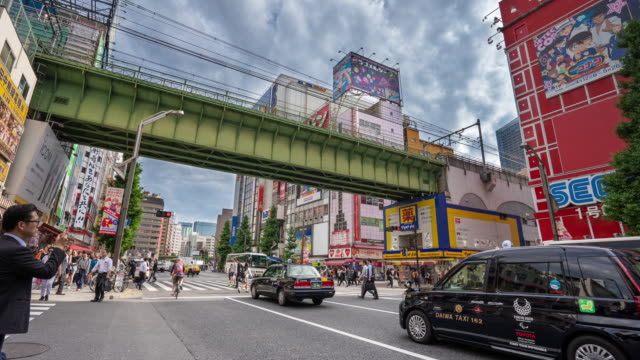 4k traffic time lapse and pedestrians walking at akihabara district, tokyo, japan. - akihabara stock videos and b-roll footage