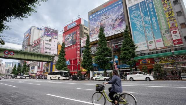 4k traffic time lapse and pedestrians walking at akihabara district, tokyo, japan. - akihabara station stock videos and b-roll footage