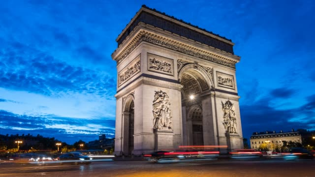 traffic time lapse at arc de triomphe in paris at night - bright stock videos & royalty-free footage