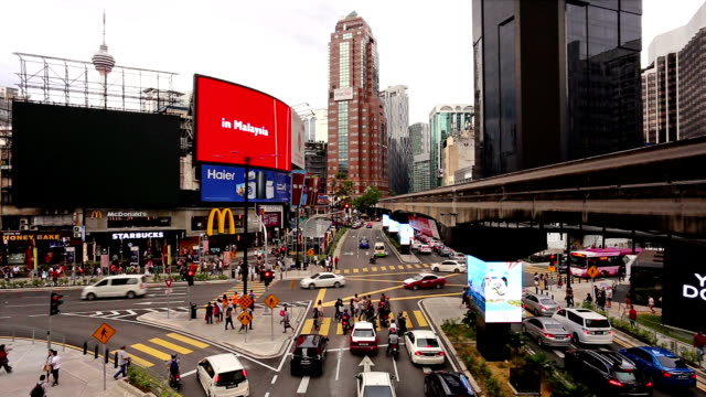 traffic time lapse in bukit bintang in kuala lumpur, malaysia capital city. - commercial sign stock videos & royalty-free footage
