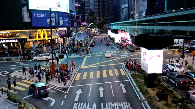 traffic time lapse in bukit bintang in kuala lumpur, malaysia capital city. - pedestrian stock videos & royalty-free footage
