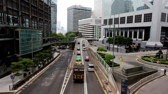 traffic time lapse in hong kong business district - hong kong island stock videos & royalty-free footage