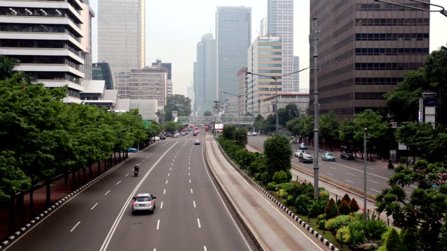 traffic time lapse in jakarta business district in indonesia capital city - newly industrialized country stock videos and b-roll footage