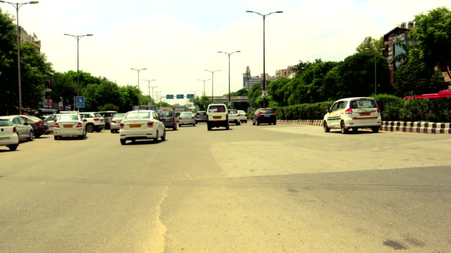 traffic time lapse, madhuban chowk, delhi, india - commuter stock videos & royalty-free footage