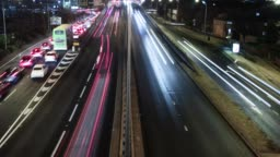 4K Traffic Timelapse with trailing red and white lights in the night on busy Motorway/Highway