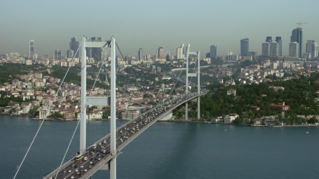 traffic travels across bridge in istanbul - july 15 martyrs' bridge stock videos & royalty-free footage
