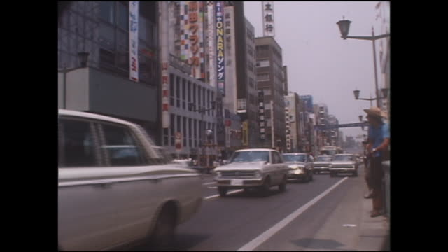 traffic travels across ginza street before the pedestrian paradise begins. - showa period stock videos & royalty-free footage
