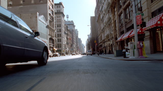 traffic travels along streets in new york city, new york. - 2001 stock videos & royalty-free footage