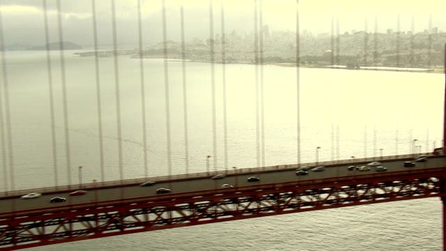 traffic travels along the golden gate bridge. - san francisco bay stock videos & royalty-free footage