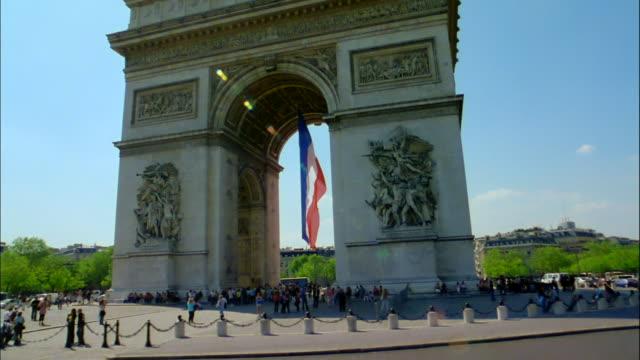 Traffic travels around the Arc de Triomphe in Paris, France.