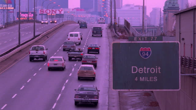 traffic travels on interstate 94 toward the detroit city limits. - downtown stock videos & royalty-free footage