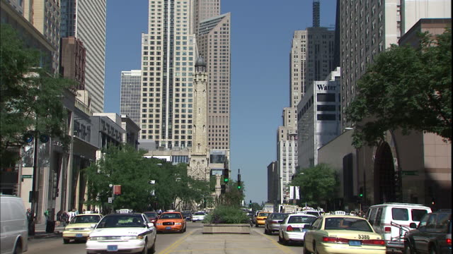traffic travels on michigan avenue in chicago, illinois. - michigan avenue chicago stock videos & royalty-free footage