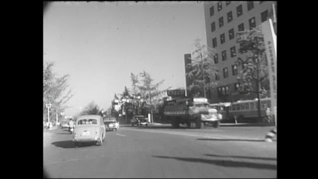 vidéos et rushes de traffic travels on the yokohama shindo through yokohama, japan. - après guerre