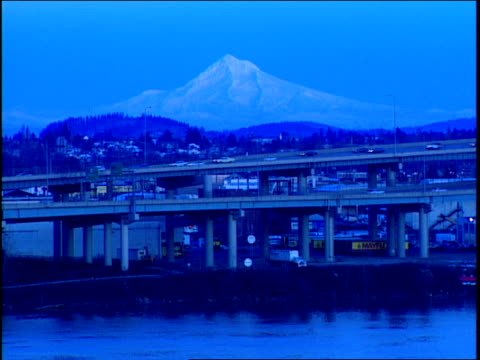 traffic travels on two bridges near mount hood in portland, oregon. - portland oregon snow stock videos & royalty-free footage