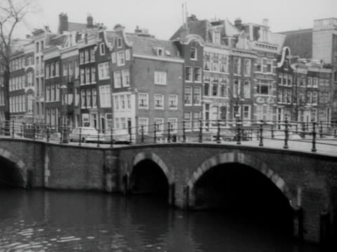 traffic travels over a bridge in amsterdam. - bbc archive stock-videos und b-roll-filmmaterial