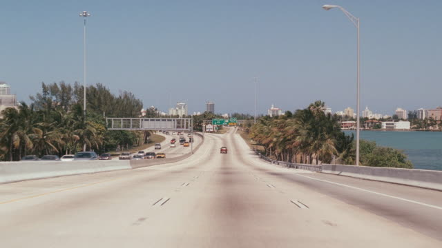 traffic travels over a freeway in miami, florida. - major road stock videos & royalty-free footage