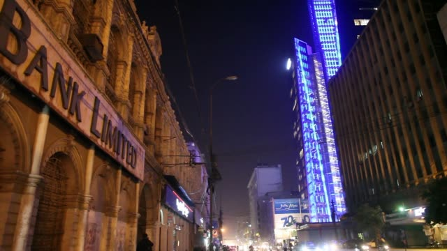 Traffic travels past a Standard Chartered Plc bank branch illuminated at night in Karachi Pakistan on Thursday Dec 14 Traffic travels past the United...