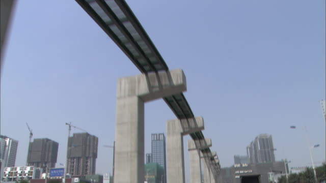 Traffic travels under a monorail construction site in Chongqing, China.
