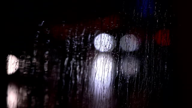 Traffic trhough rainy window