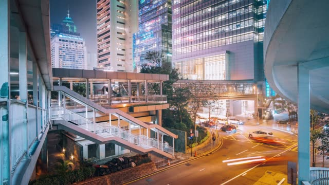 traffic trough hongkong business district, 4k timelapse - wealth stock videos & royalty-free footage