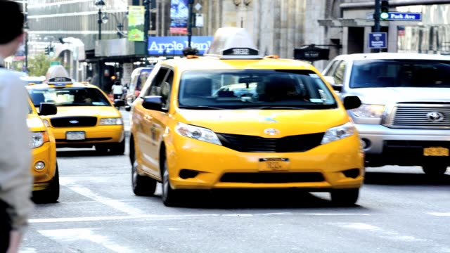 traffic via 42nd street grand central terminal during summer morning rush hour pershing square park avenue midtown manhattan new york city usa - 42nd street stock videos & royalty-free footage