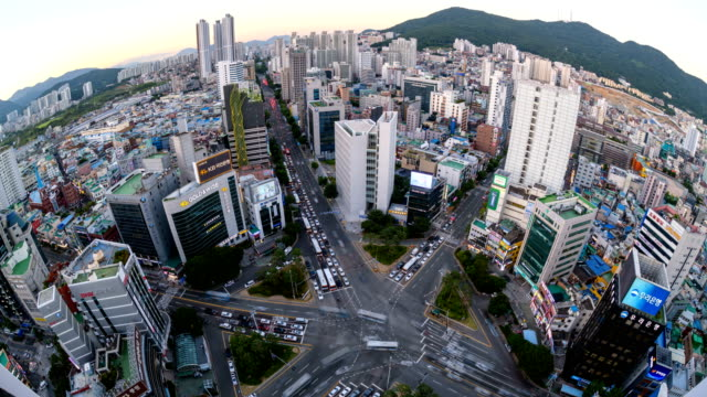traffic view from day to night at the intersection of seomyeon main street, busanjin-gu district, busan - busan stock videos & royalty-free footage