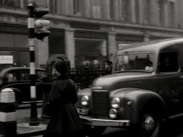 traffic waits for a fleet of double decker buses to move along oxford circus. - double decker bus stock videos & royalty-free footage