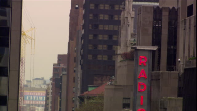 traffic waits on a congested street in front o radio city in new york city, new york. - radio city music hall stock videos & royalty-free footage