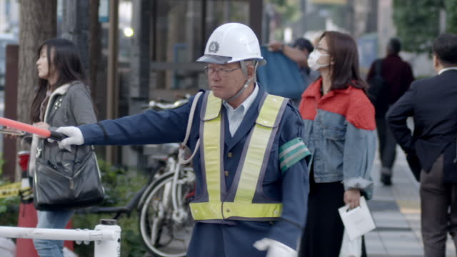 traffic warden and people crossing a road, tokyo - fashion week stock videos & royalty-free footage