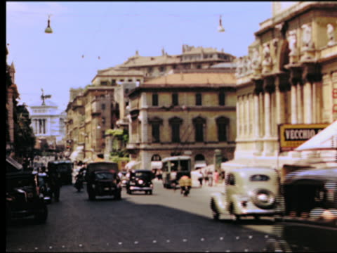 stockvideo's en b-roll-footage met 1949 traffic with bus, truck + motorcycle on city street / rome, italy - 1949