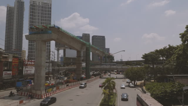 traffic with cityscape at aerial view downtown bangkok. - crane shot stock videos & royalty-free footage
