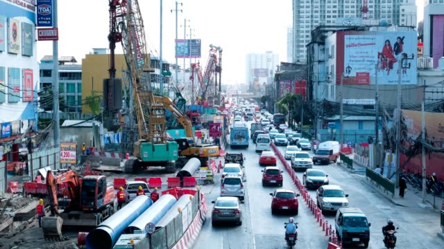traffic with construction on ramkhamhaeng road bangkok thailand. - bangkok stock videos & royalty-free footage